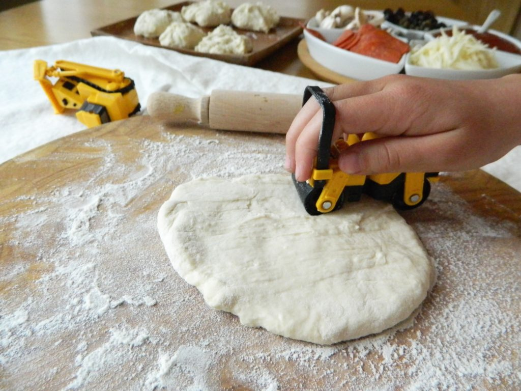 Rolling out Mini No-Knead Pizzas - finestofsuppers.com