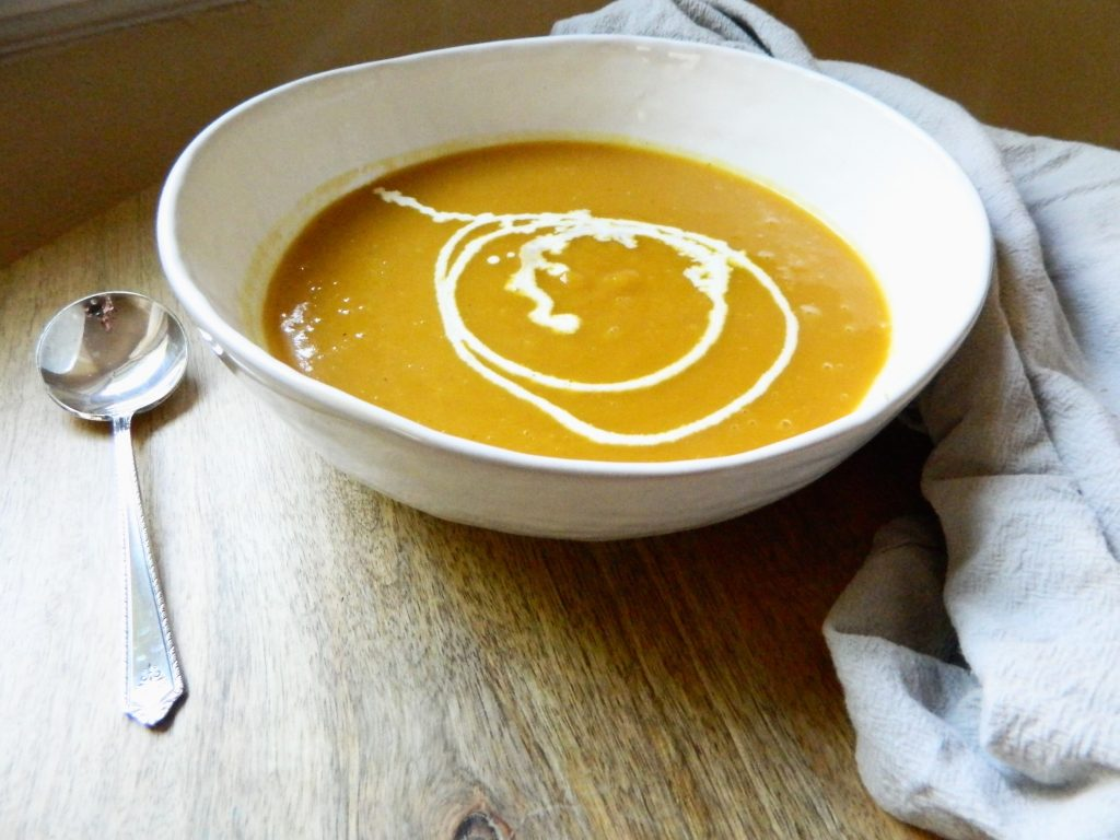 a bowl of Roasted Pumpkin Soup - finestofsuppers.com