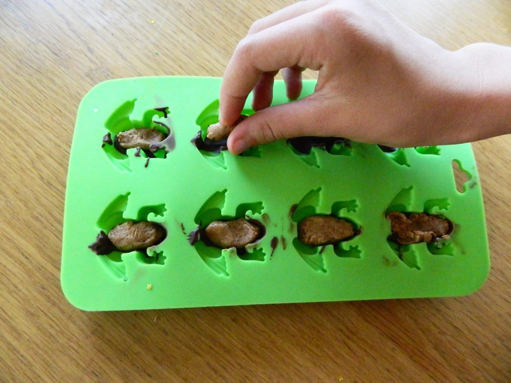 Adding filling to Dark Chocolate Almond Butter Frogs - finestofsuppers.com